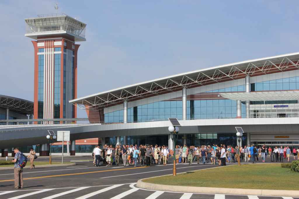 First ever tourists arrive and await tourist busses at new Wonsan Airport DPRK North Korea Sep 24, 2015
