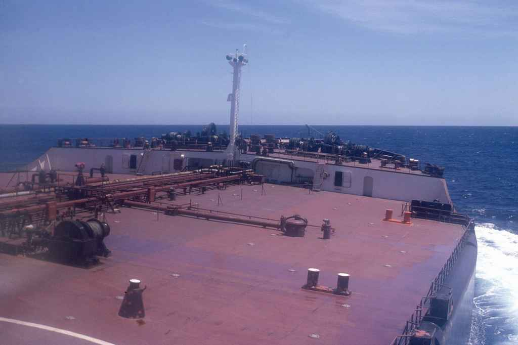 At sea, listing forward deck of the MV L.W Funkhouser approaching Cape Town South Africa whilst being resupplied by Court Line S-61
