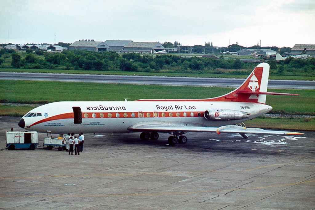 Royal Air Lao Caravelle XW-PNH on the apron at at Bangkok 1975. Photo by Ron Kosys.