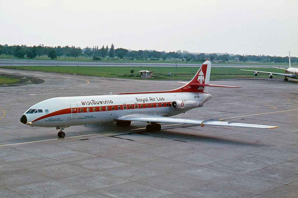 Royal Air Lao Caravelle XW-PNH taxiing at at Bangkok 1975. Photo by Ron Kosys.