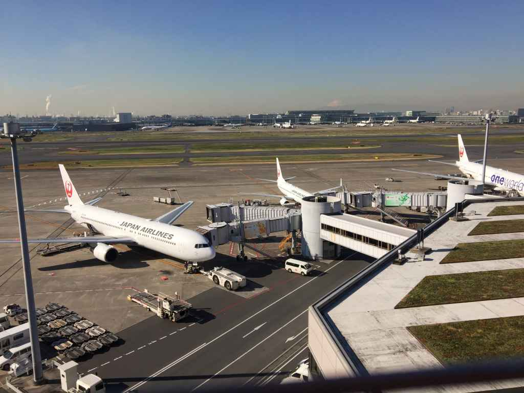 Spartan JAL aircraft on the gates viewed from the obsdeck on Tokyo Haneda JAL Terminal 1.