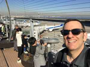 Henry Tenby on the obsdeck at Tokyo Haneda ANA Terminal 2 with Tokyo Bay in the background.