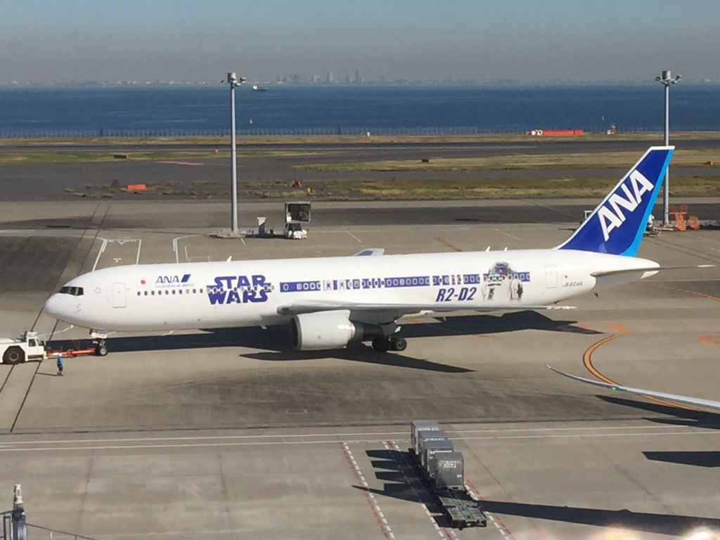ANA Star Wars 767 at the obsdeck at Tokyo Haneda ANA Terminal 2 with Tokyo Bay in the background