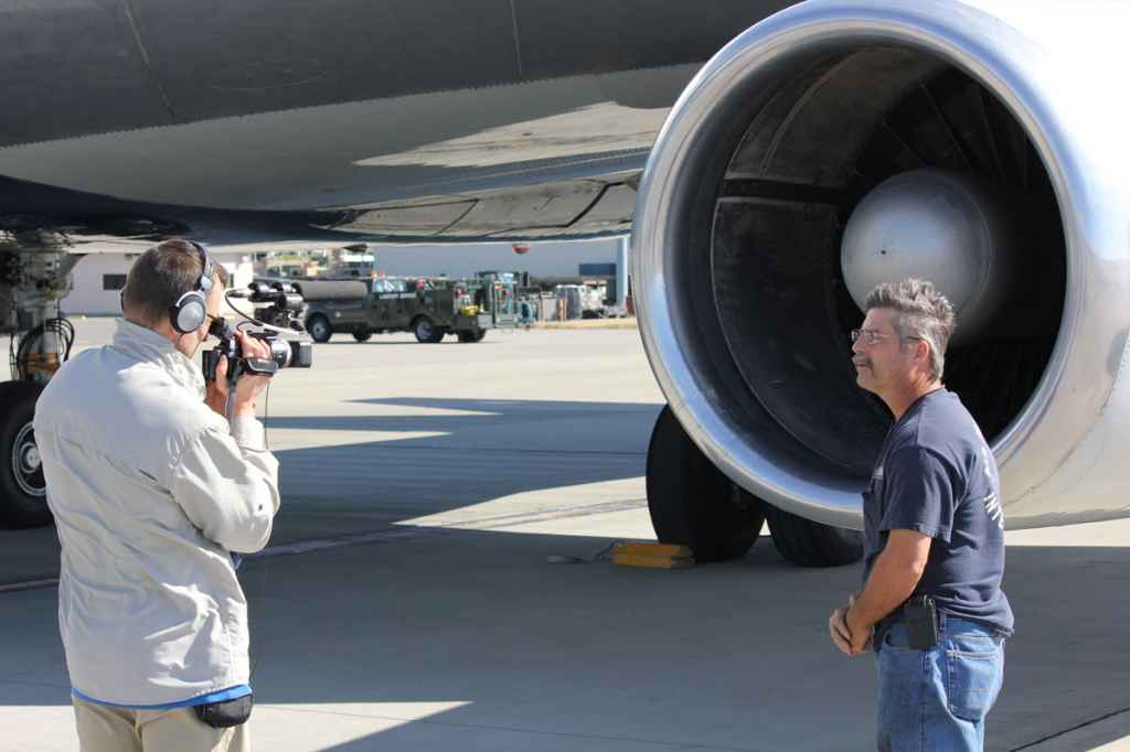 Henry Tenby interviews ATI maintenance engineer Phil Sisco on the apron.