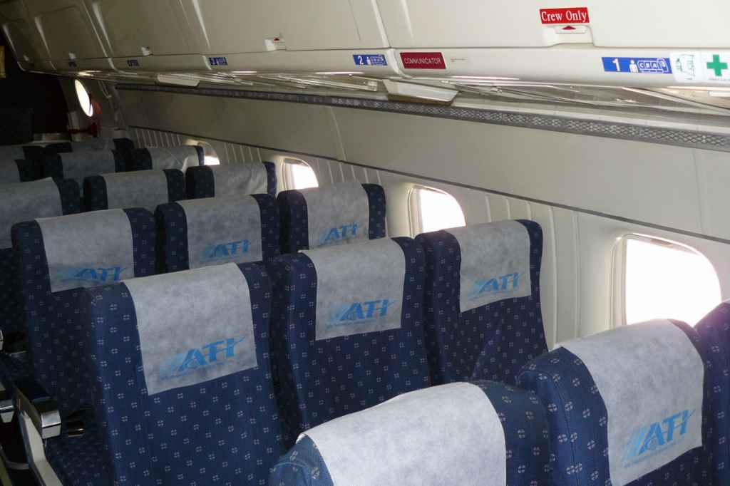 ATI's DC-8-62 combi had a 32-seat aft cabin. A fixed smoke barrier and 9g bulkhead separated the forward cargo section. Each row of seats, set at 34 inch pitch, lined up with a generously sized window , which is larger than a 787 window.