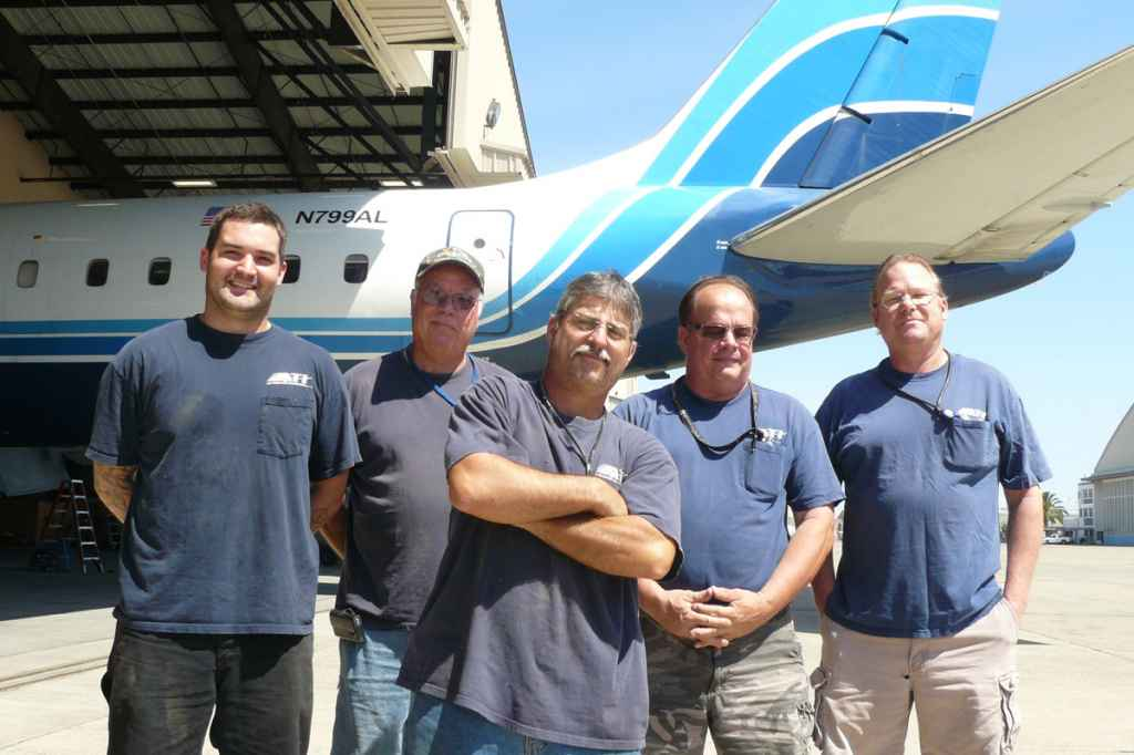 ATI McClellan manager Robert Dobler (far right) and the McClellan maintenance crew pose for a group portrait and the last day of ATI DC-8 operations. The service now operates with ATI 757 aircraft.