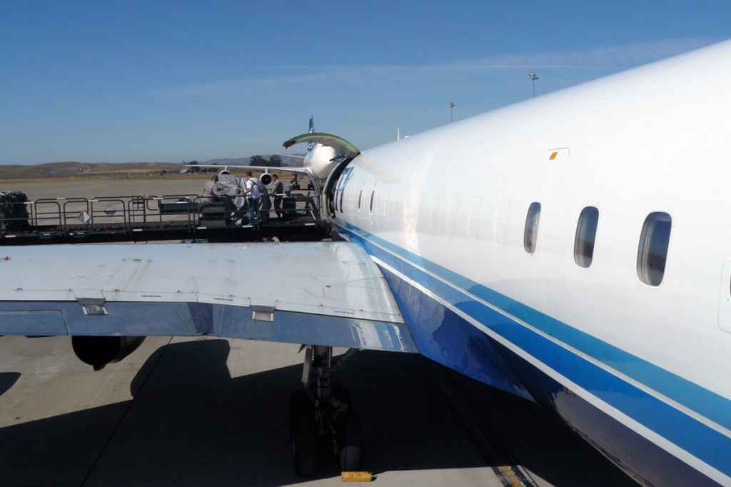 Pallet loaders are used for the quick loading of the ATI DC-8 at Travis.