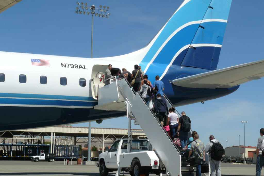 Honolulu bound military passengers board ATI DC-8-62 N799AL at Travis AFB for the last time ever on May 12, 2013.