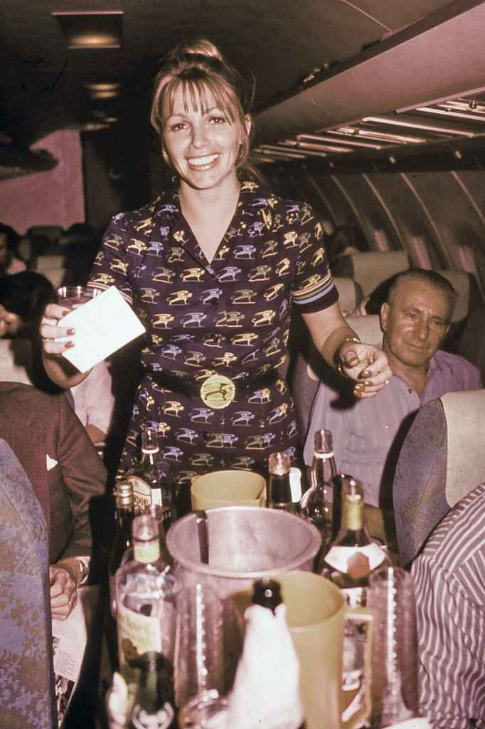 Flight attendant and cocktail service aboard Bavaria BAC One Eleven Fun Jet circa early 1970s.
