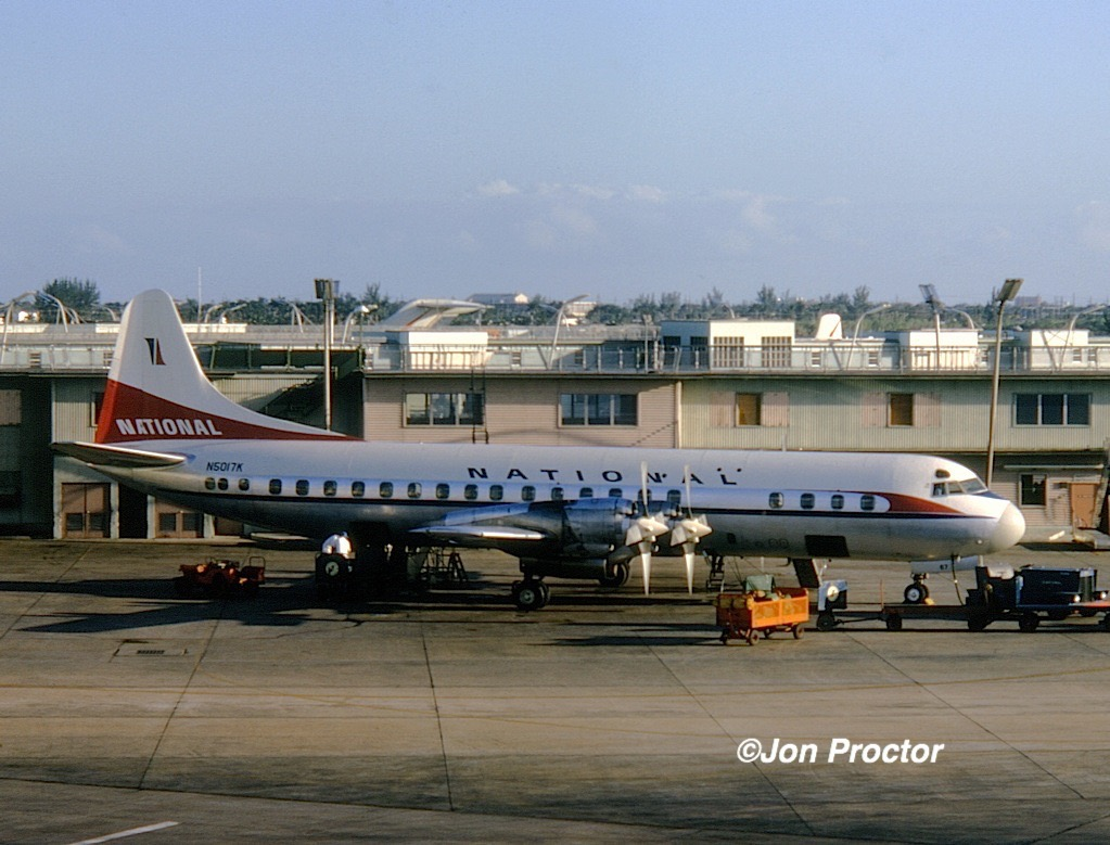 Feb, 1965: National Electra N5017K rests at the gate. Note the empty observation deck above the aircraft. (Jon Proctor photo)