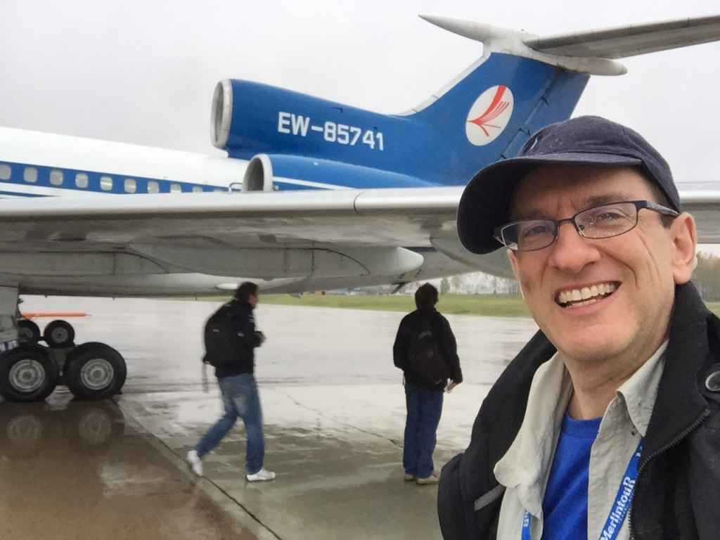 Pissing with rain while boarding Belavia Tu154 at Minsk. Destination .. Saint Petersburg. A pleased as punch Henry Tenby savours the moment in the lashing rain by taking an iPhone selfie.