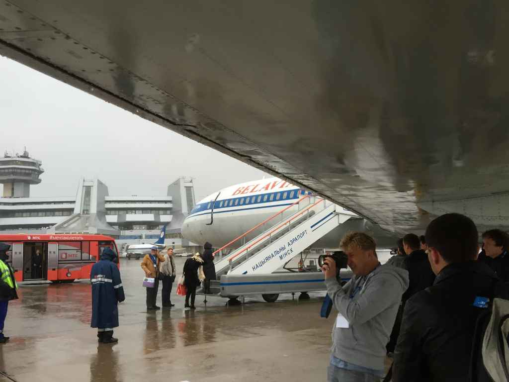 As it was chucking it down during our boarding, many of the aviation fans took refuge from the elements under the wing of the Belavia Tu154, to let other passengers board in a non rushed manner. Standing under of the wing of a Tupolev 154 prior to an active service is not something one gets to savour every day! Hence the abundance of cameras!