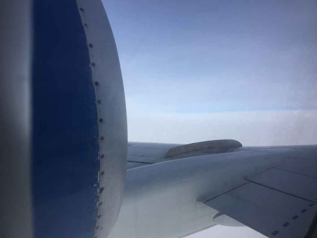 View through the window in the emergency door at row 30. it is a very unique view that can only be a Tupolev 154 .. or a Tu134.