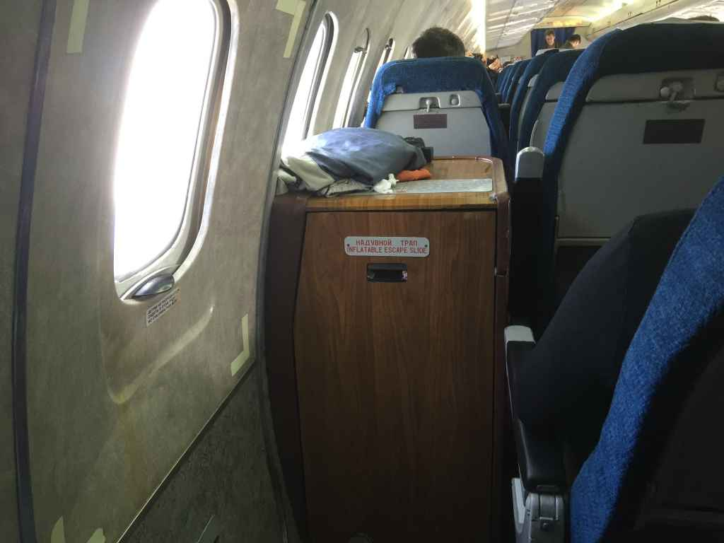 This is the view seated on the last row seat 31A. WIth seat 30A removed there is loads of leg room. But it is a rather long stretch to access the window for photos and filming. Note that seat 29 has the cabinet of the slide raft between the chair and window, and this makes for a very interesting setup for camera etc.