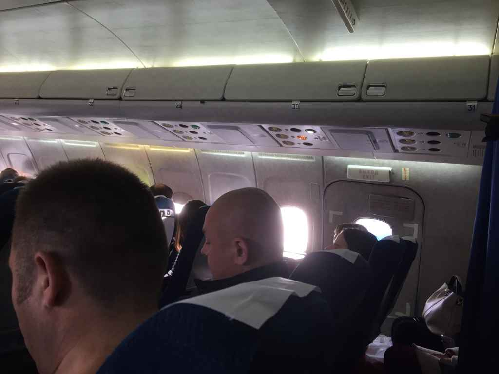 As shown in this photo, the actual emergency door exit is at row 30 on the Belavia Tu154, and the very last row is one behind at row 31. Row 30 only has seats BC and DE (A and F have been removed so as not to interfere with emergency door exit procedures).
