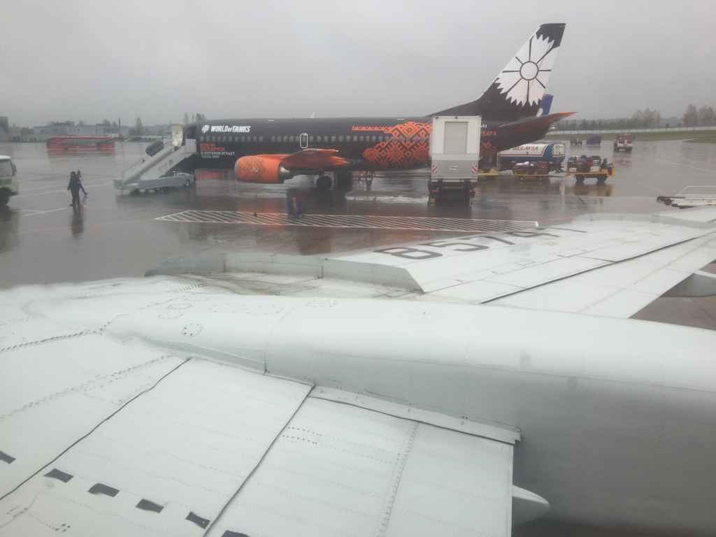 View from my seat 26F just as we pulled into position on the parking stand beside a 737-300 logo jet of Belavia.