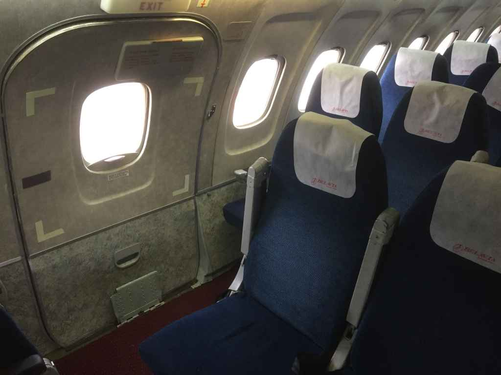 Mid cabin emergency exit row on the Belavia Tu-154.