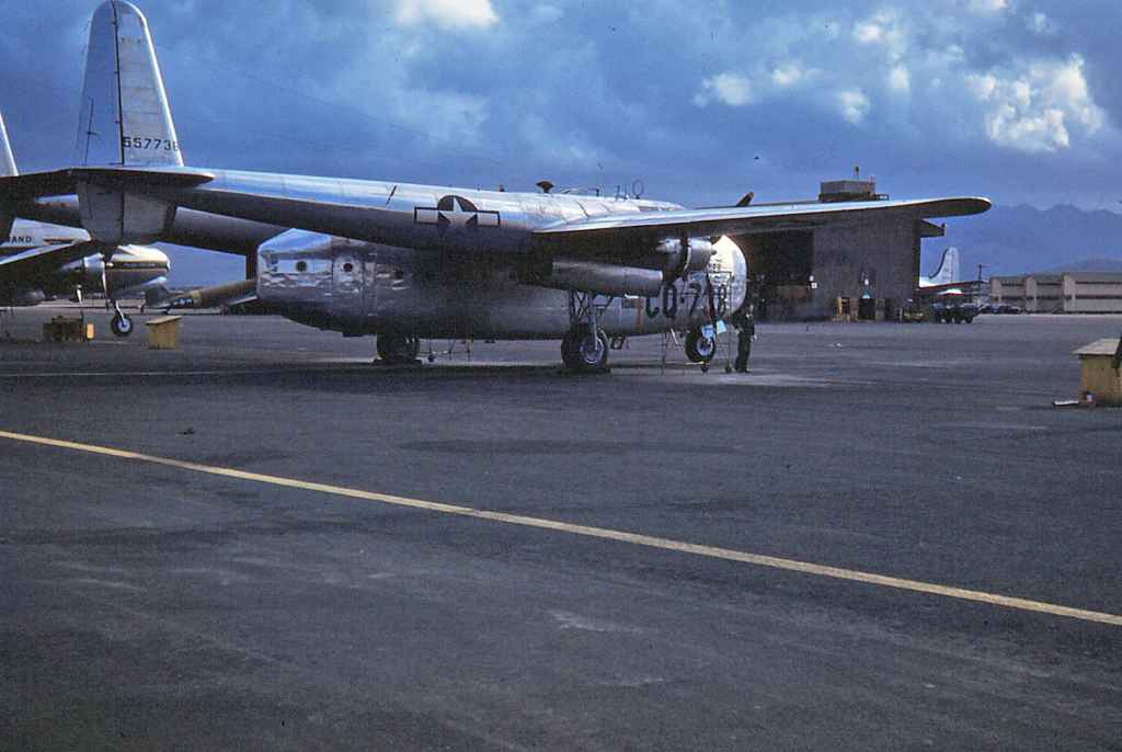 US Air Force C-119 Flying Boxcar is serviced on the ramp at Hickam Air Force Base in Holoulu, Hawaii, circa early 1950s.