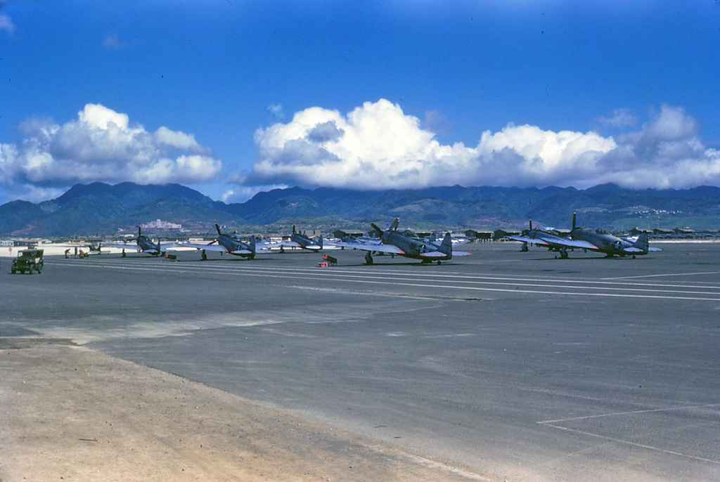 Very historic image of USAF P-47D Thunderbolts lined up on the Hickam AFB apron taken during post World War II in the late 1940s. Glorious kodachrome.