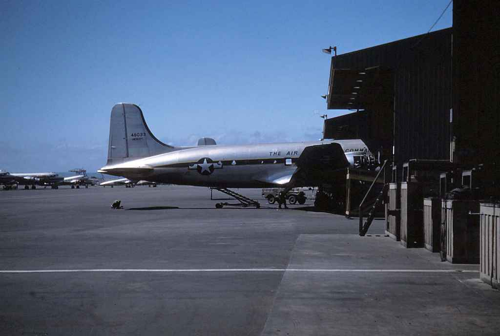 "Hickam was naturally a major repair facility for the US Air Force, as seen by these maintenance sheds, which remained at Honolulu well into the 1980s. This early 1950s image shows  49033 USAF MATS C-45 Skymaster. The ""Hickam"" title on the tail denotes that this aircraft was locally based."