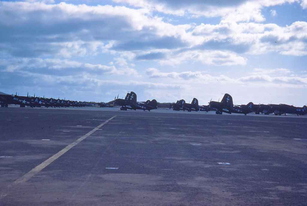 A very busy and well protected Hickam apron, circa mid to late 1940s. We have rows of Curtiss Sb2 Helldivers, as well as Corsair IIs.