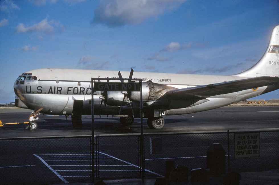 "Looking good! A USAF MATS C-97 Boeing Startocruiser 0694 having just arrived either from the West Coast or the Far East. Here passenger door is open and she rests at Hickam's ""Gate No 1"" in this period early 1950s kodachrome view."