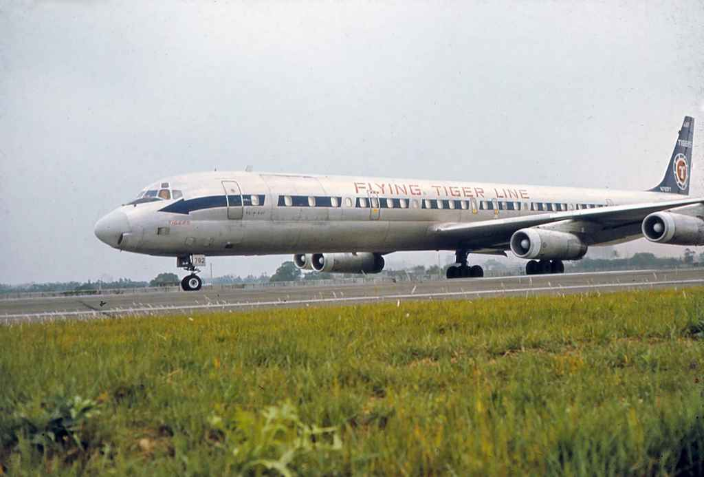Flying Tigers DC-8-63 N782FT operating a Vietnam War charter at Taipei Sung Shan airport circa 1971.