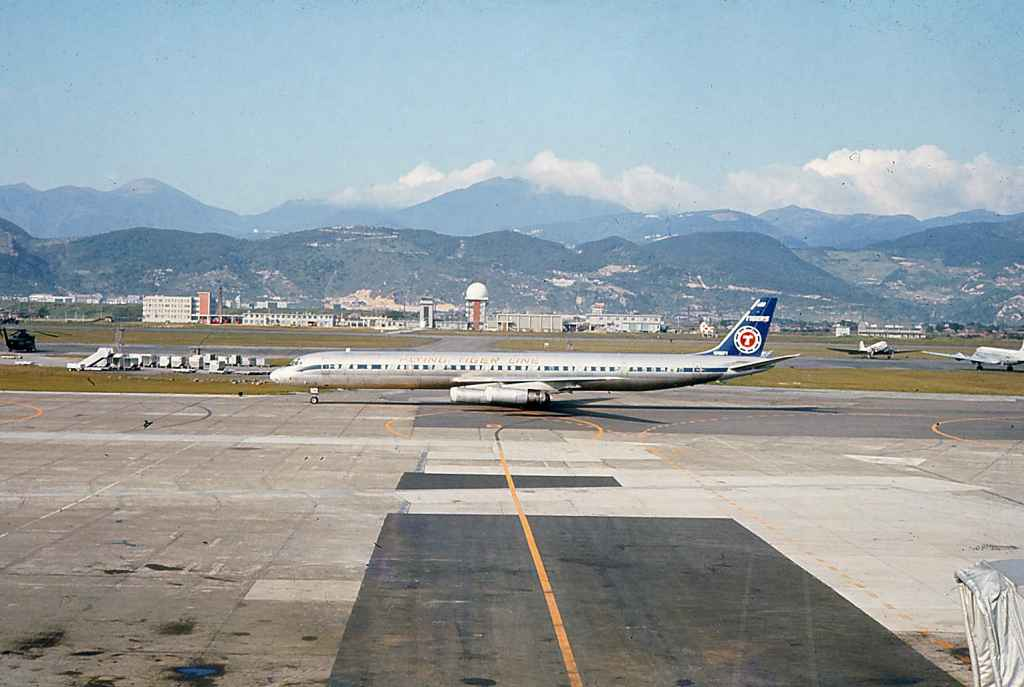 Flying Tigers DC-8-63 mid apron at Taipei Sung Shan airport circa 1971.