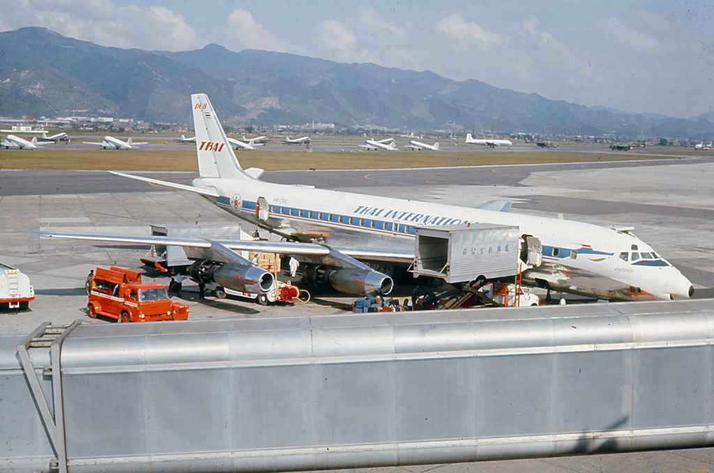 Thai International DC-8-30 HS-TGO operating a sked service Flying Tigers DC-8-63 N782FT operating a Vietnam War charter at Taipei Sung Shan airport circa 1971.