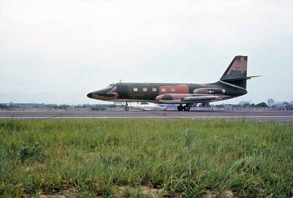 USAF Lockheed C140 Jetstar O-35960 at Taipei Sung Shan airport circa 1971. Probably on a maintenance visit or some other Vietnam War related VIP charter. Note the Vietnam War camouflage scheme. This aircraft was used to test navigational aids.