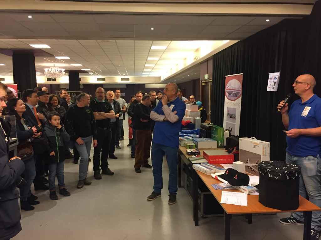 This is show organizer Patrick van Rooijen officiating the door prize raffle.