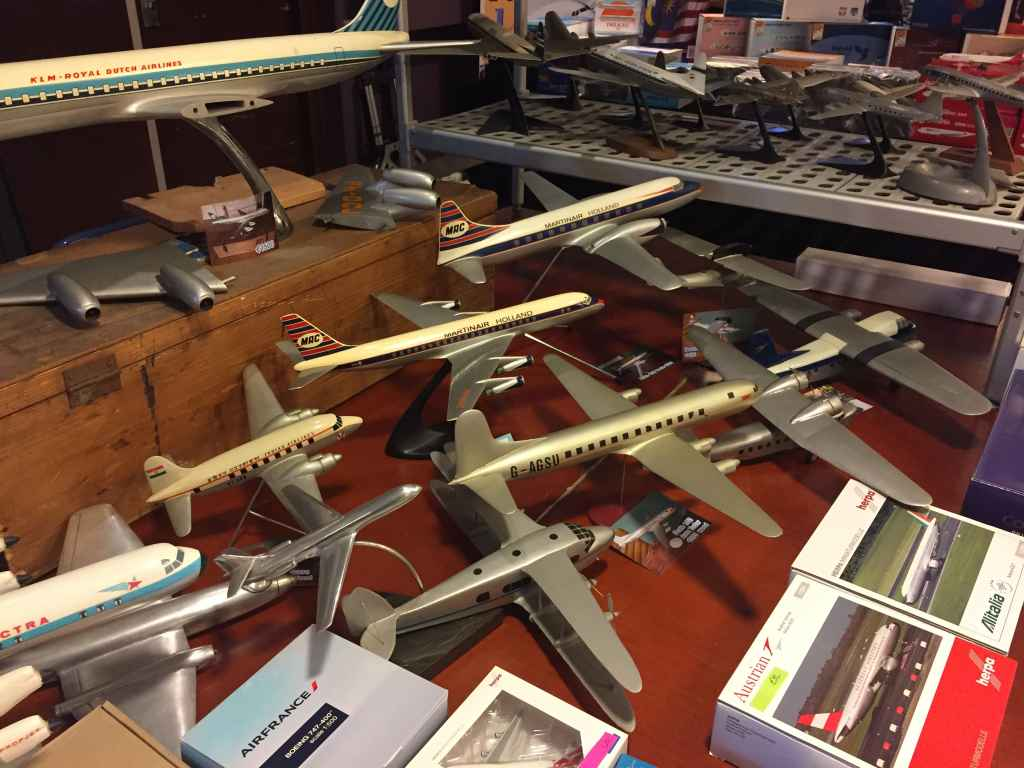 Big Raise Up KLM 1/50 DC-8 at top, with Verkulyl Martinair DC-8 1/100 in metal, a 1/50 Martinair Convair 640 in resin and an assortment of refinished wooden ID models, all offered for sale at the Amsterdam Aviation Fair 2019.