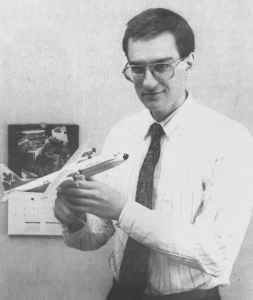 Apart from taking and trading photos of airplanes, Henry Tenby has also amassed a large collection of airplane models, and is seen here admiring an NWT Air Hercules in his Yellowknife office.
