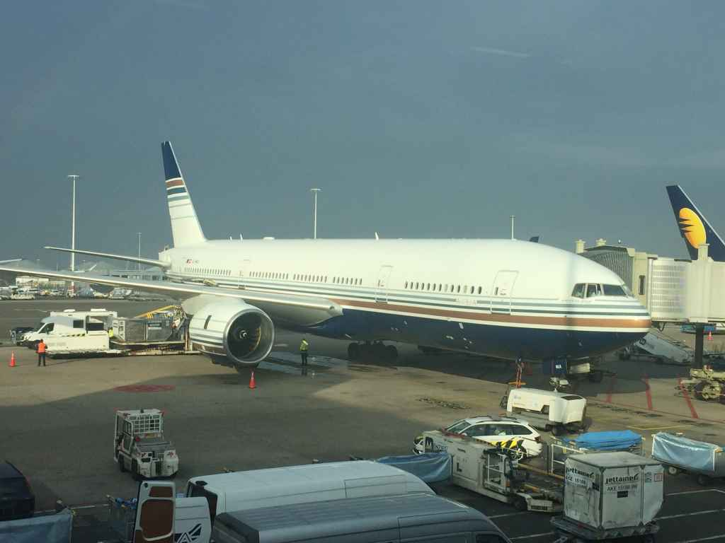 """Privilege Triple Seven 300ER """"Auria"""" at Amsterdam Schiphol airport viewed from the boarding gate."""
