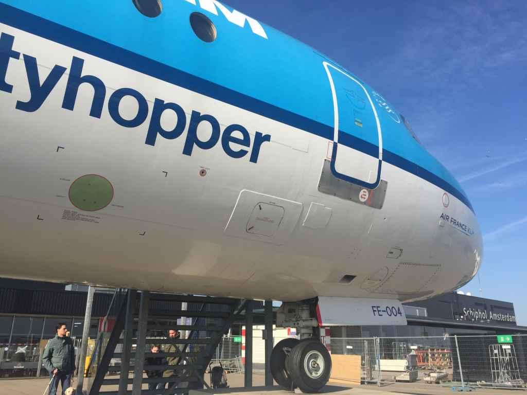 KLM Fokker 100 on display on top of the observation deck at Amsterdam Schiphol Airport.