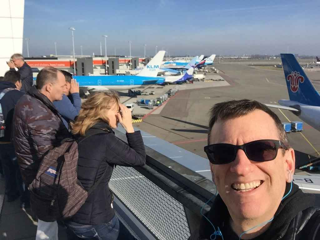 Henry Tenby thoroughly enjoying his time soaking up the action on the open air observation deck at Amsterdam Schiphol airport.