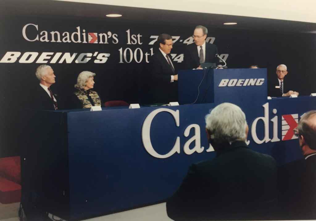 """CAIL Chief Executive Rhys Eyton on the podium. This was the special handover ceremony of Canadian Airlines' first Boeing 747-475 """"Maxwell Ward"""" at Boeing Field, December 13, 1990, prior to delivery to Vancouver. The video of this event stream at http://www.jetflix.tv"""