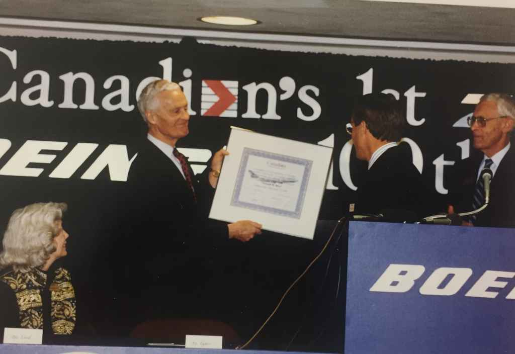 """A Boeing exec presents a delivery certificate to Rhys Eyton. This was the special handover ceremony of Canadian Airlines' first Boeing 747-475 """"Maxwell Ward"""" at Boeing Field, December 13, 1990, prior to delivery to Vancouver."""