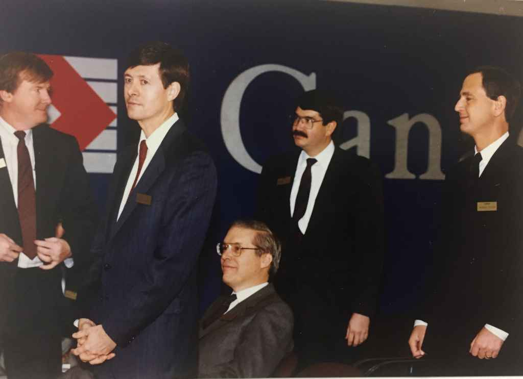 """Canadian Airlines top brass on hand for the handover ceremony of Canadian Airlines' first Boeing 747-475 """"Maxwell Ward"""" at Boeing Field, December 13, 1990, prior to delivery to Vancouver."""