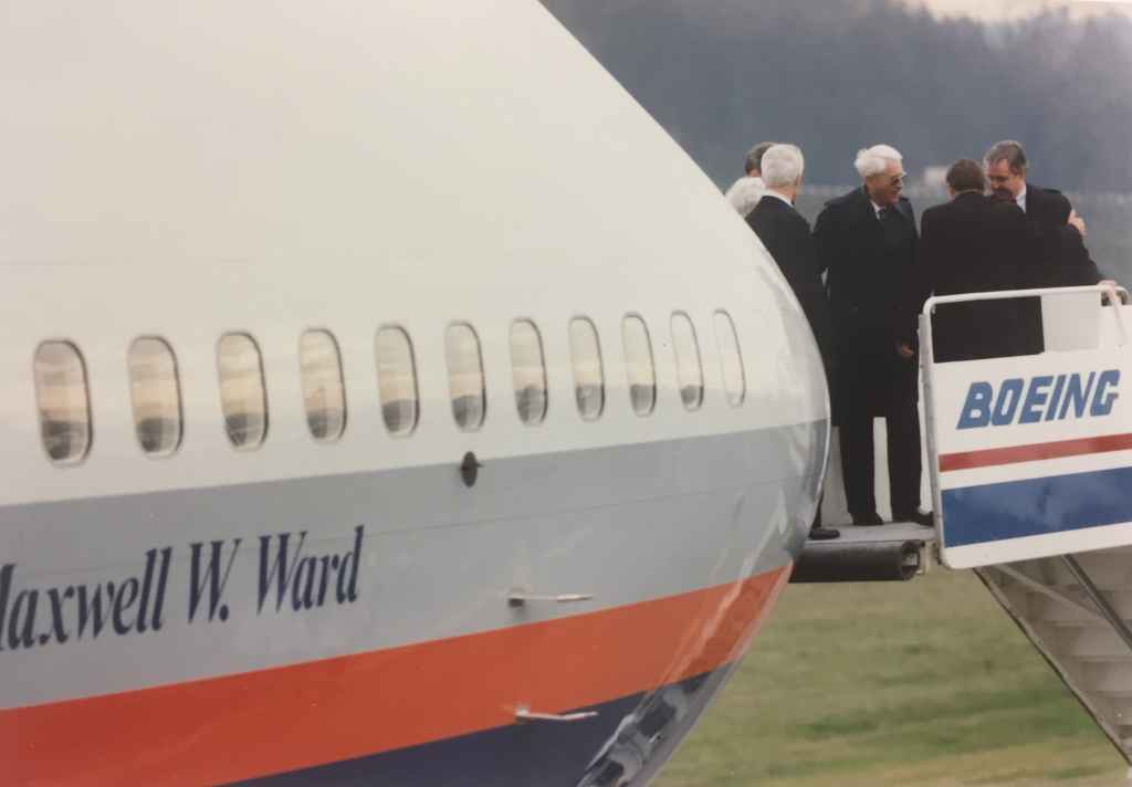 """Max Ward's wife and Rhys Eyton and others christening Canadian Airlines' first Boeing 747-475 """"Maxwell Ward"""" at Boeing Field, December 13, 1990, prior to delivery to Vancouver."""