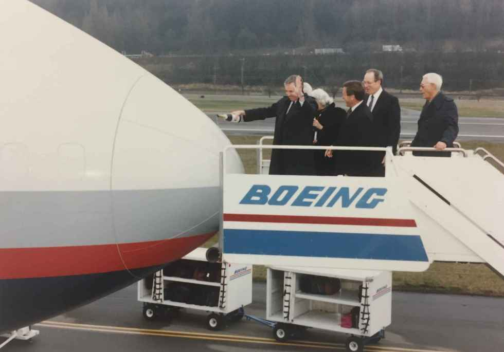 """Max Ward's wife and Rhys Eyton christening Canadian Airlines' first Boeing 747-475 """"Maxwell Ward"""" at Boeing Field, December 13, 1990, prior to delivery to Vancouver."""
