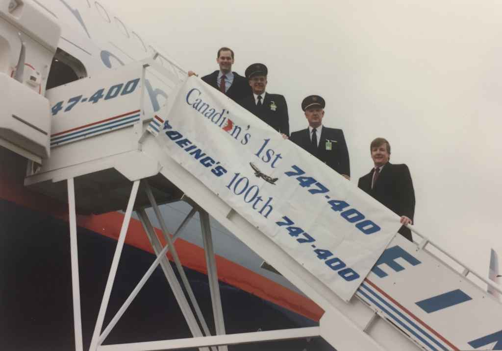 """Kevin Jenkins top of the stairs, with CAIL air crew of Canadian Airlines' first Boeing 747-475 """"Maxwell Ward"""" at Boeing Field, December 13, 1990, prior to delivery to Vancouver."""