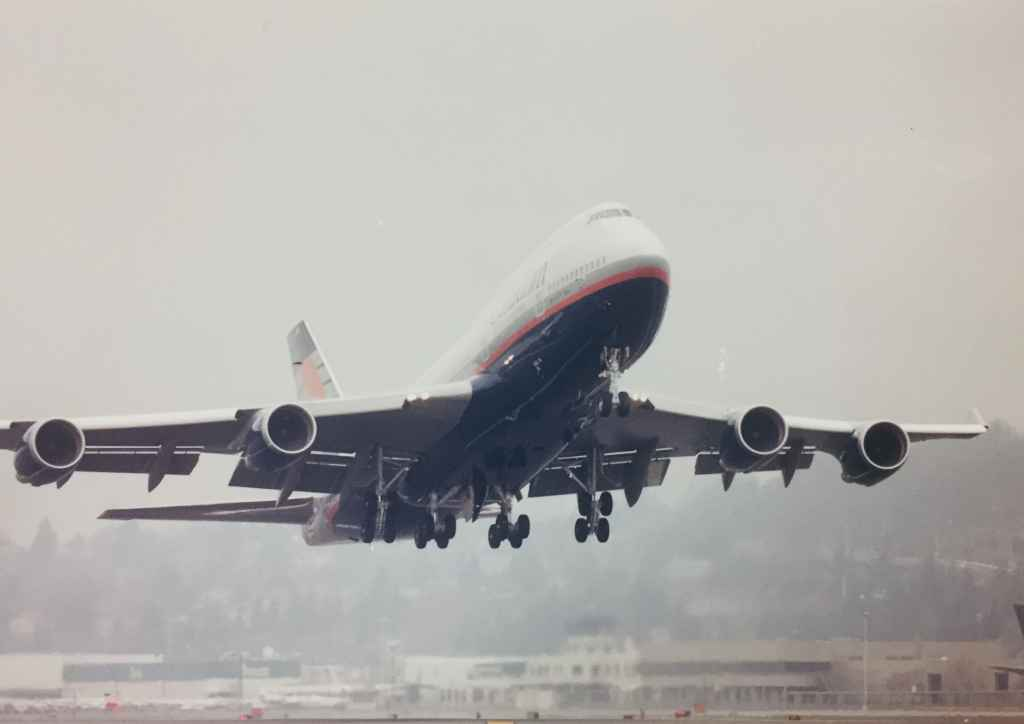 """Canadian Airlines Boeing 747-475 """"Maxwell Ward"""" departing Boeing Field, December 13, 1990, on delivery to Vancouver."""