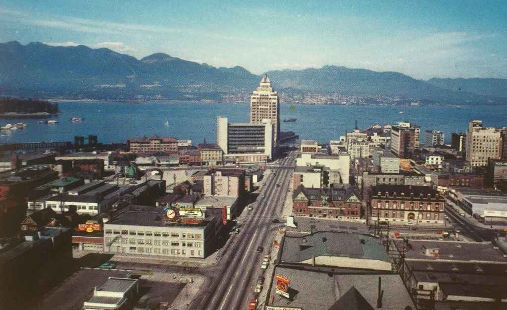 "The Customs and Marine Building on the waterfront at the north end of Vancouver's Burrard Street, stands majestic against the city's vibrant harbour. Notice how empty the now traffic clogged Burrard street was in the mid 1950s! According to the caption on the back of the card ""The North Shoreline Mountains are snow-covered most of the year and form excellent skiing grounds. Two electric ski lifts make this ski playground famed throughout the Northwest."" (Postcard published by Vancouver Magazine Services LTD., Vancouver, B.C.)"