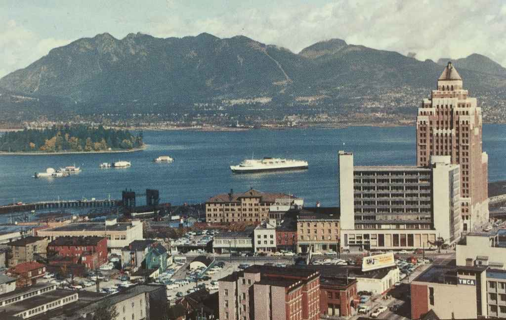 Another view of the Customs and Marine Building on the waterfront at the north end of Vancouver's Burrard Street, with the YMCA in the lower right of the image. Notice all the available ground level parking lots that were available back then. (Kodachrome Postcard published by The Coast Publishing Company, Vancouver, Canada.)