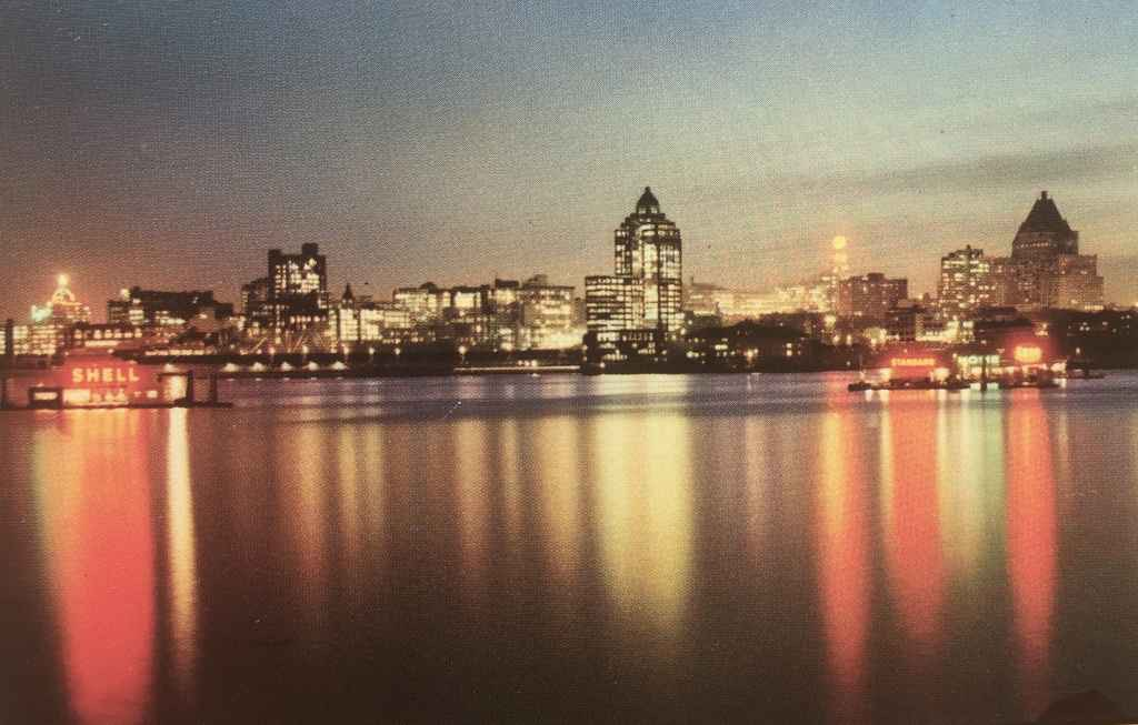 Vancouver, BC, Canada waterfront view at dusk circa 1954. (Kodachrome postcard published by The Coast Publishing Company, Vancouver, BC)