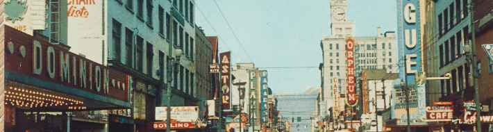 "Granville Street Vogue and Orpheum Theatres circa 1954. Granville is Vancouver's busiest and most colourful street, showing the heart of the city's vibrant theatre district, with its numerous neon signs. (Grant-Mann Lithographers LTD ""COLOR CARD"" division, Vancouver, BC)"