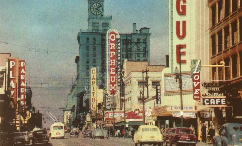 Granville Street Vancouver BC circa 1954. Photo was taken looking north in the heart of the city's theatre district with numerous neon signs. This street is the main street of Vancouver and extends from West 70th near the airport, all the way to the wharf, a length of 10 miles. (Colour photo courtesy of Canadian Pacific Railway, post card published by Vancouver Magazine Services LTD.)