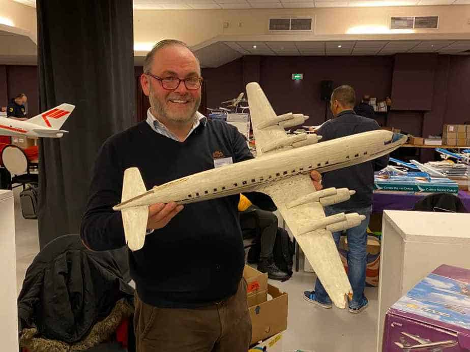 Peter Casell with his wooden 1/50 DC-7 model, in need of serious restoration.